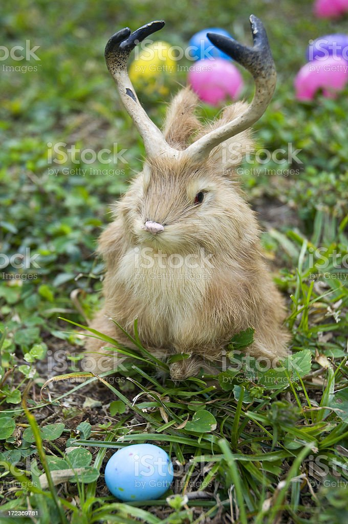 Easter Bunny Jackelope In Grass With Colorful Eggs royalty-free stock photo