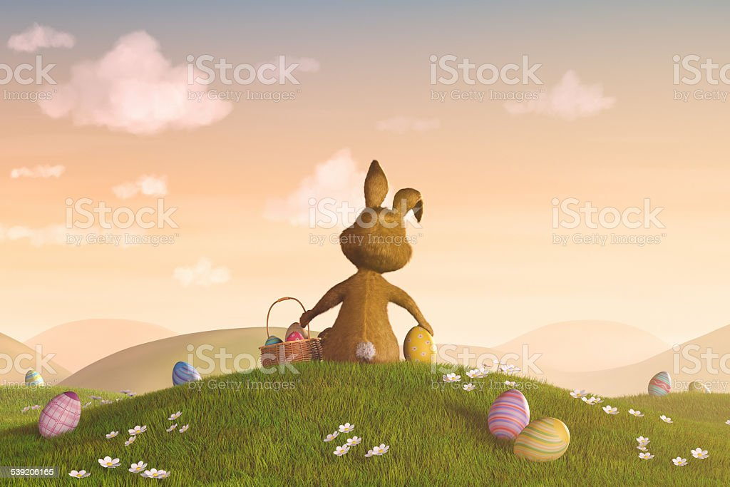 Easter bunny with a basket and eggs stock photo