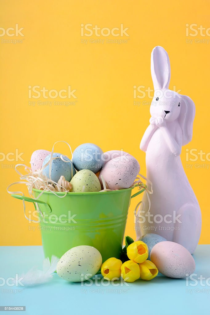 Easter Bunny with Bucket of Eggs stock photo