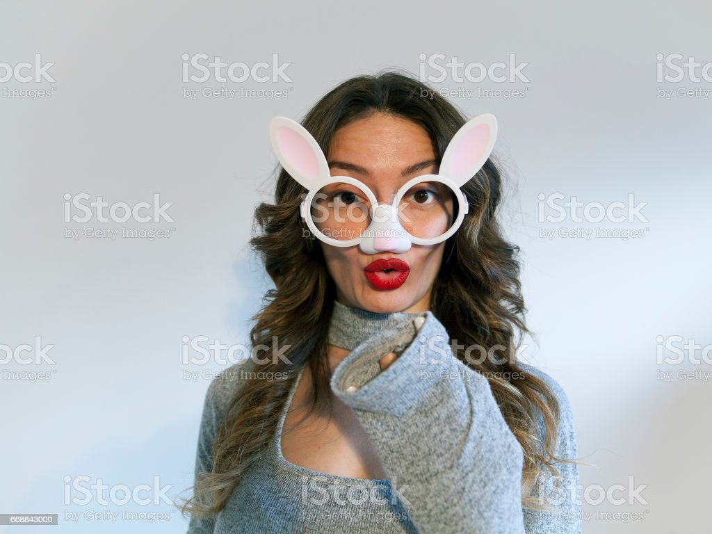 Easter bunny woman / Attractive girl with funny glasses stock photo