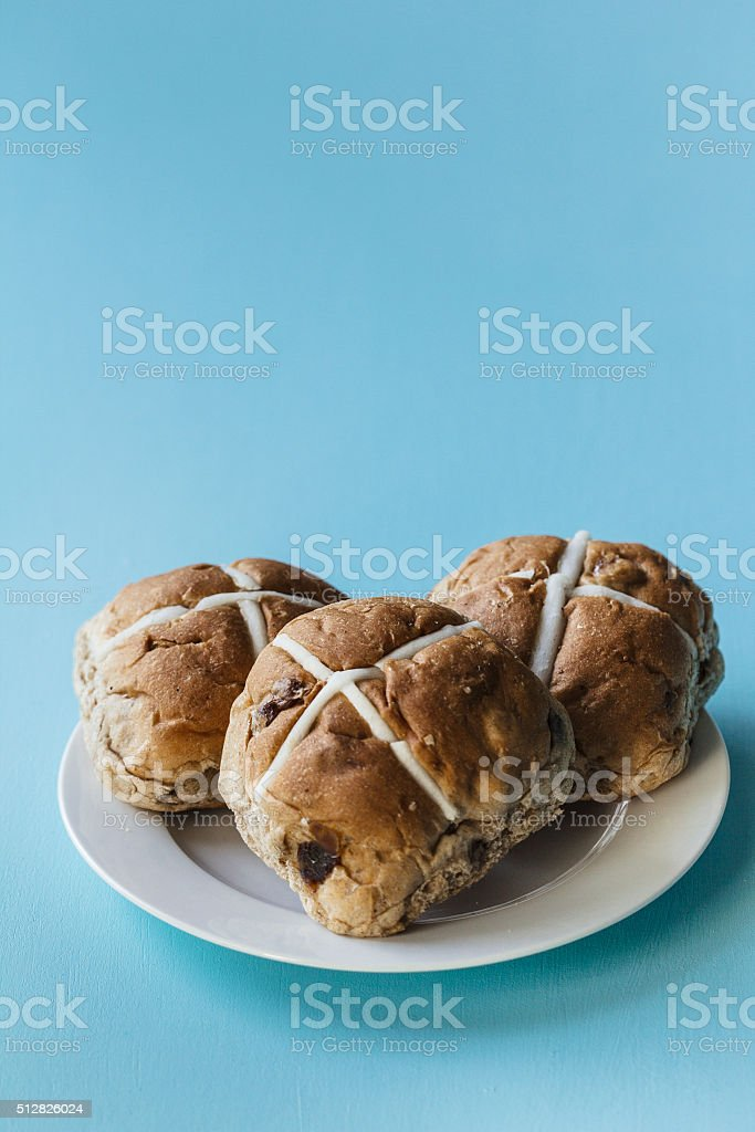 Easter buns on a white plate stock photo