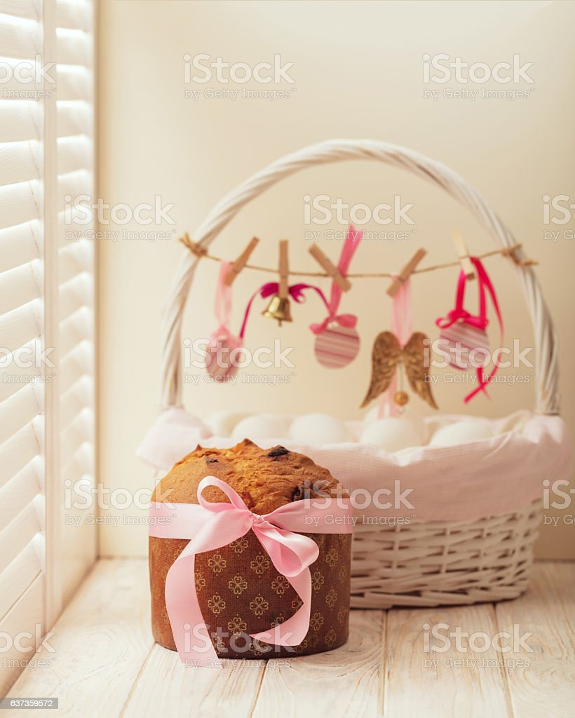 Easter cake and basket with eggs and Easter decor. stock photo