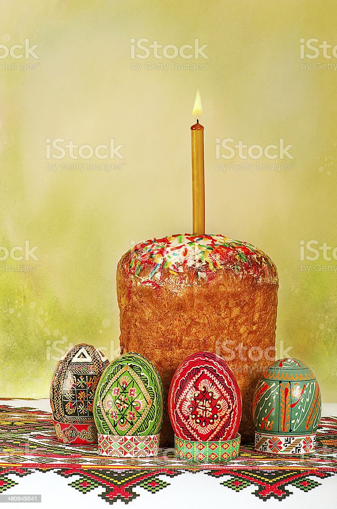 Easter cake and Easter eggs on embroidery, postal stock photo
