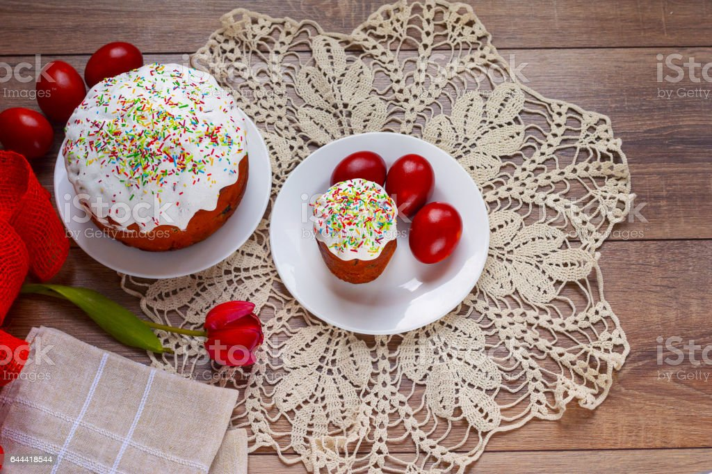 Easter cake and painted eggs on a table stock photo