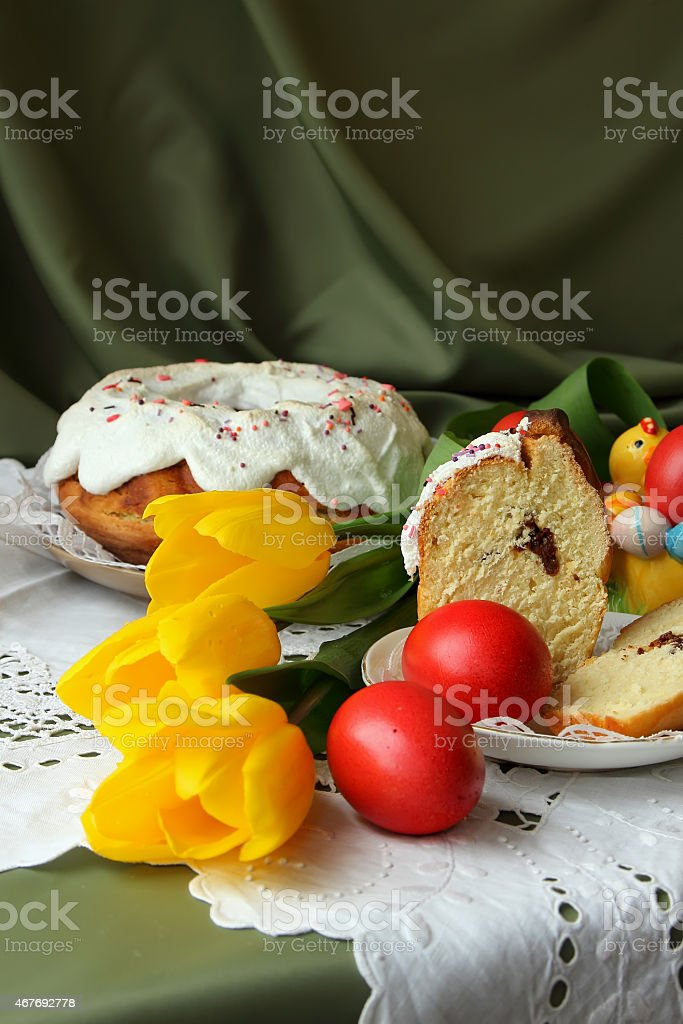 Easter cake, painted eggs and tulips. stock photo