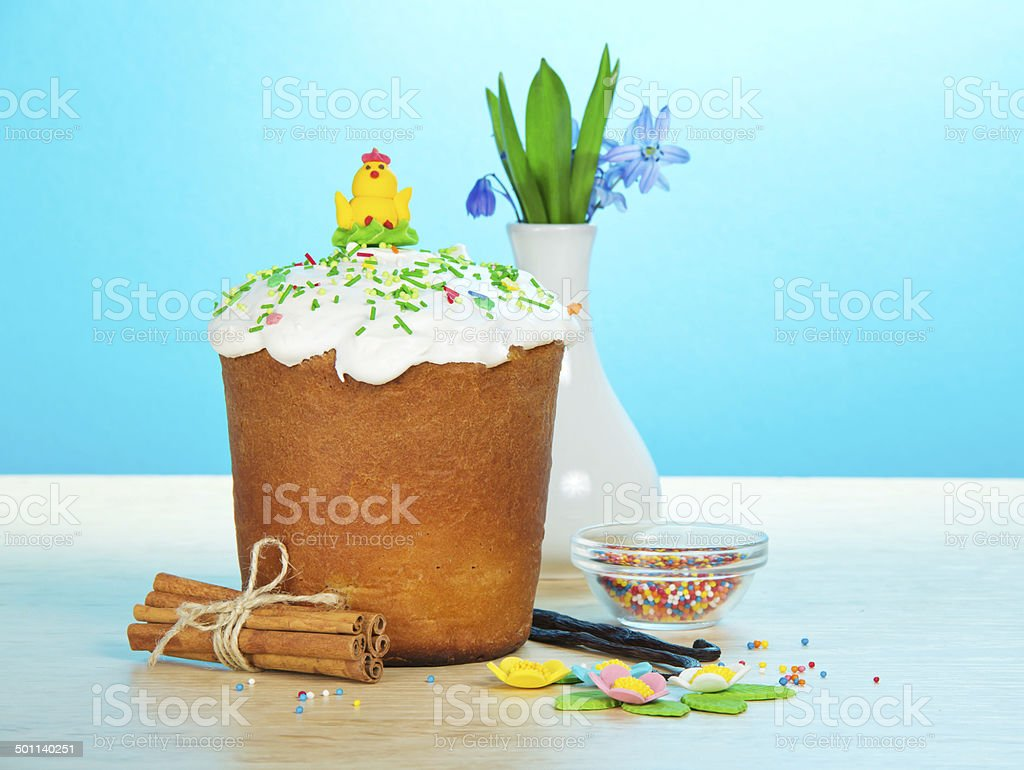 Easter cake, sweet jewelry, spices and flowers stock photo