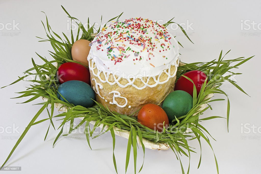 Easter cake with eggs in wicker vase royalty-free stock photo