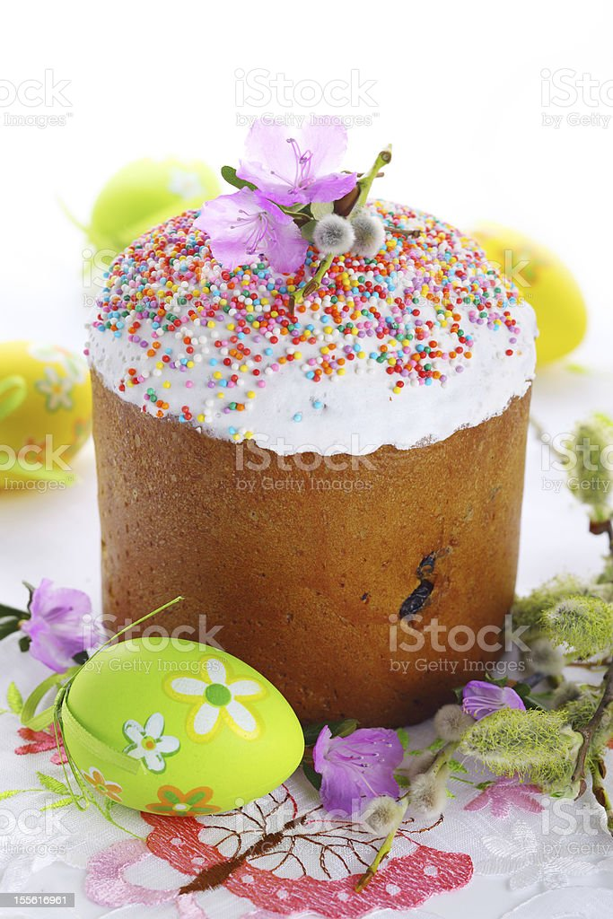 Easter cake with glace icing and eggs on white background. royalty-free stock photo