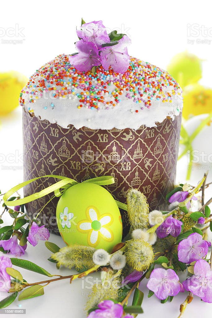 Easter cake with glace icing and willows on white background stock photo