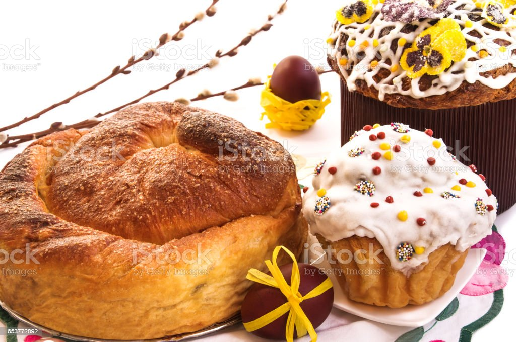 Easter cakes, eggs and willow branches on white. stock photo