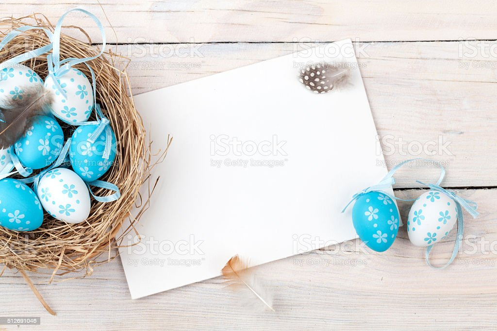 Easter card with blue and white eggs in nest stock photo