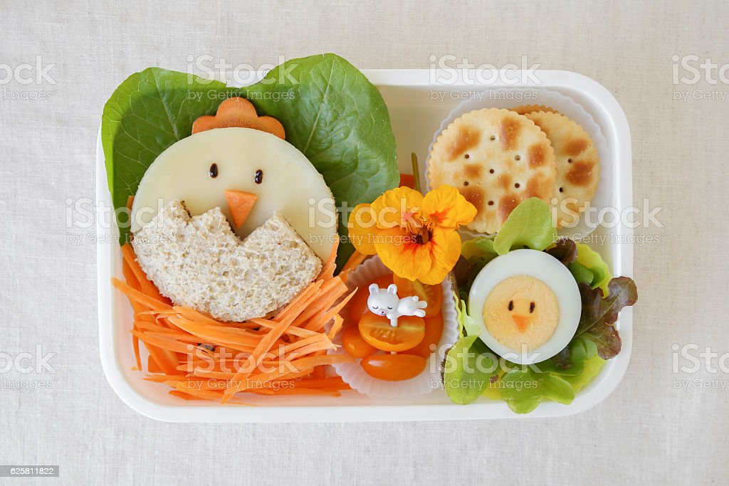 Easter chick lunch box, fun food art for kids stock photo