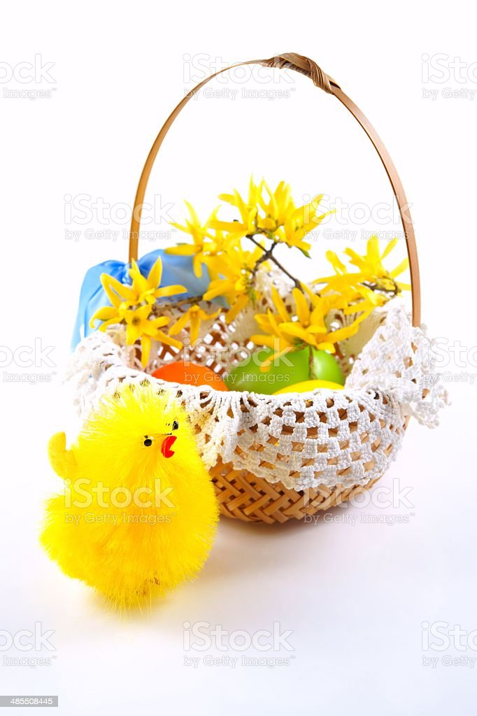 Easter chicken and eggs in basket on white background royalty-free stock photo