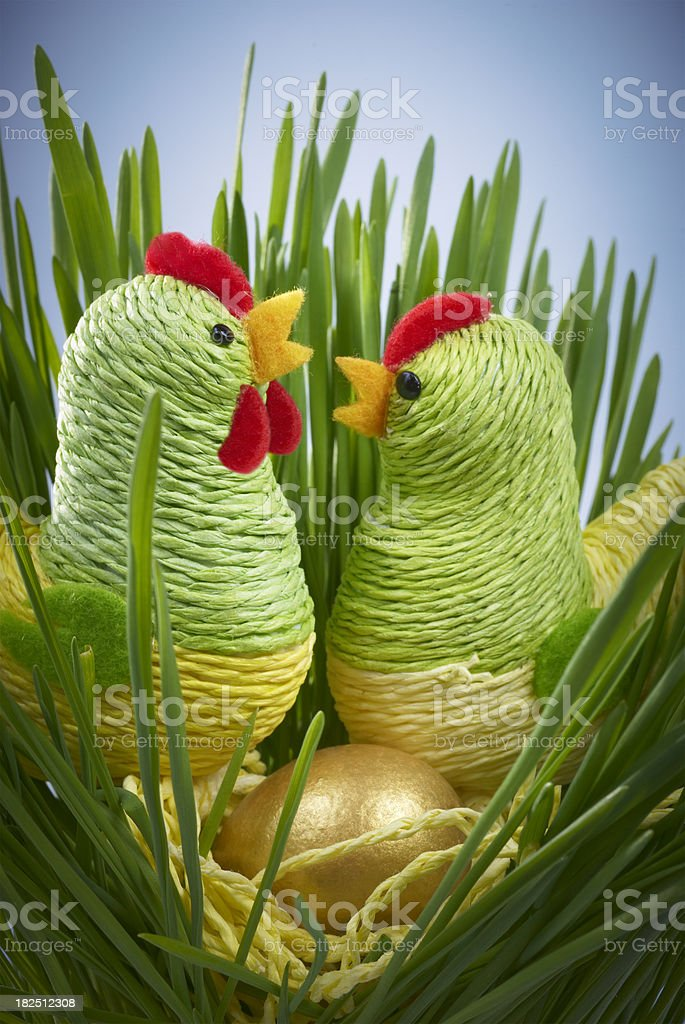 Easter Chickens and Golden Egg in Grass stock photo