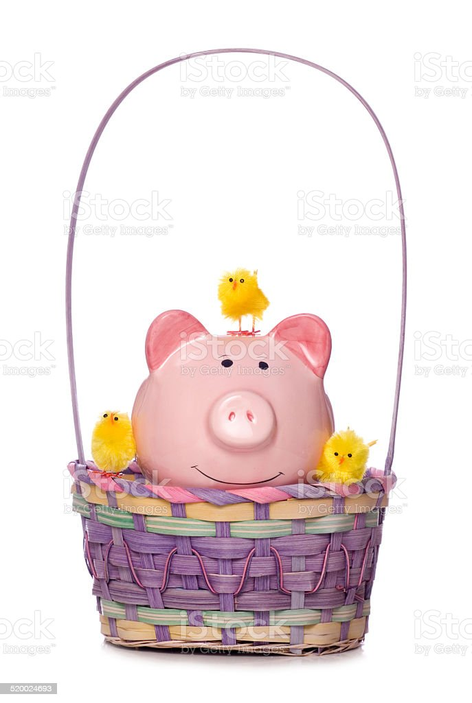 easter chicksand piggy bank in a basket cut out stock photo