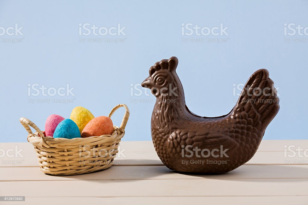 Easter chocolate chicken and eggs over a table stock photo