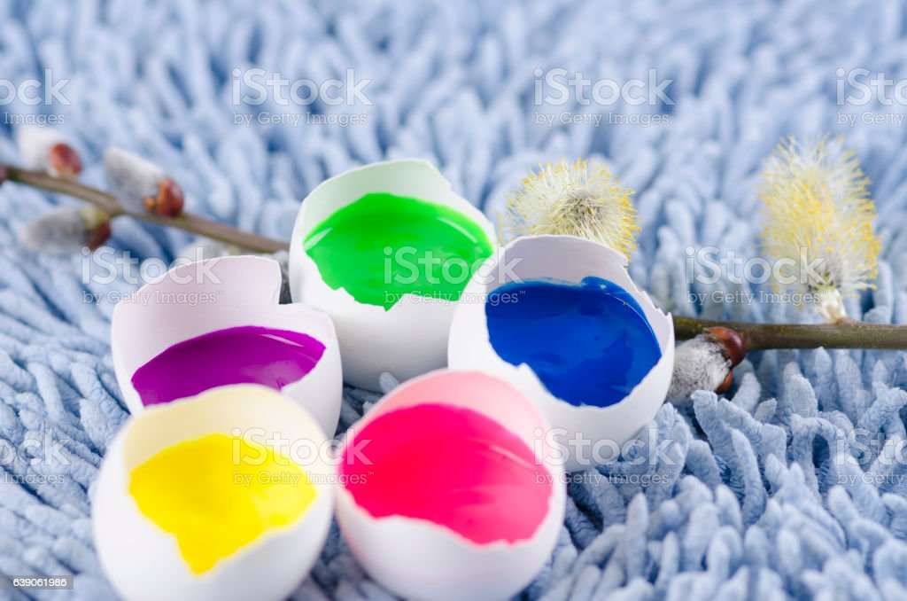 Easter colorful decoration with egg shells and spring flowers stock photo