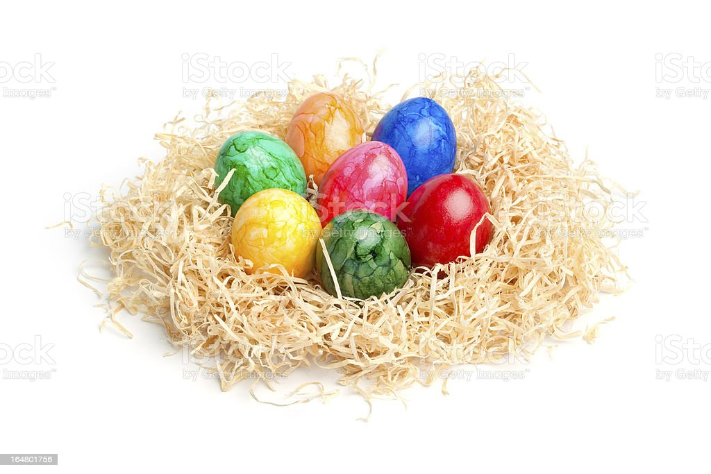 Easter - Colorful Eggs in a Wood Wool Nest royalty-free stock photo