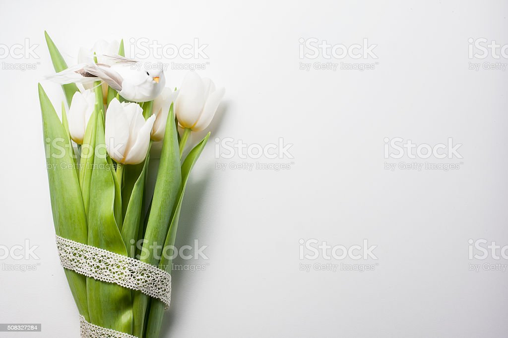 easter composition consists of a white tulips, quail eggs stock photo