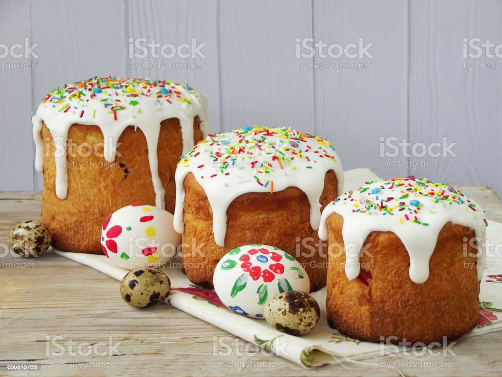 Easter composition of sweet bread, paska and eggs on light wooden background. Orthodox kulich. Holidays breakfast concept with space for text. stock photo