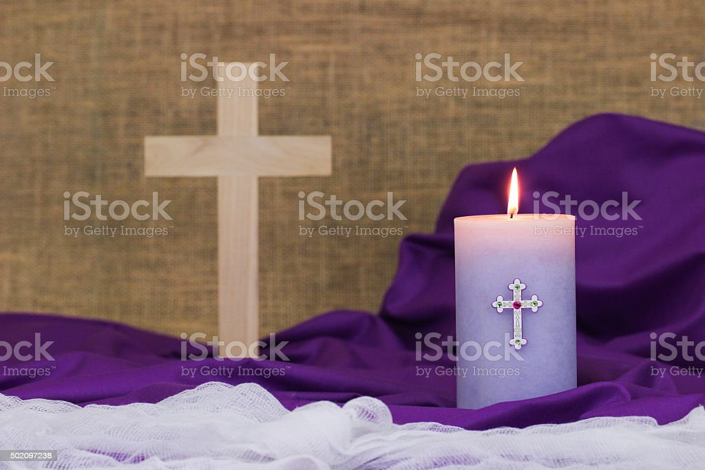 Easter composition with candle and wood cross stock photo