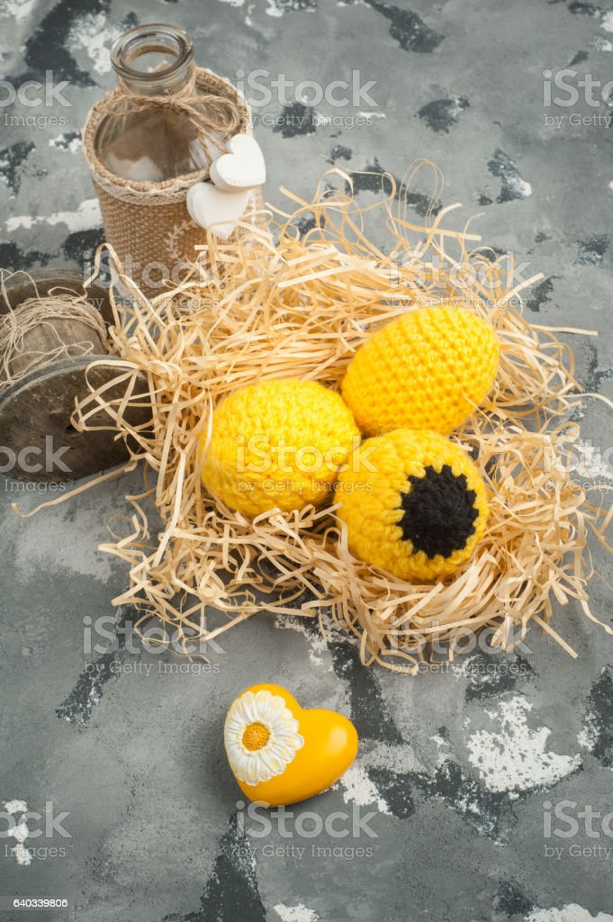 Easter composition with decorative knitted eggs stock photo