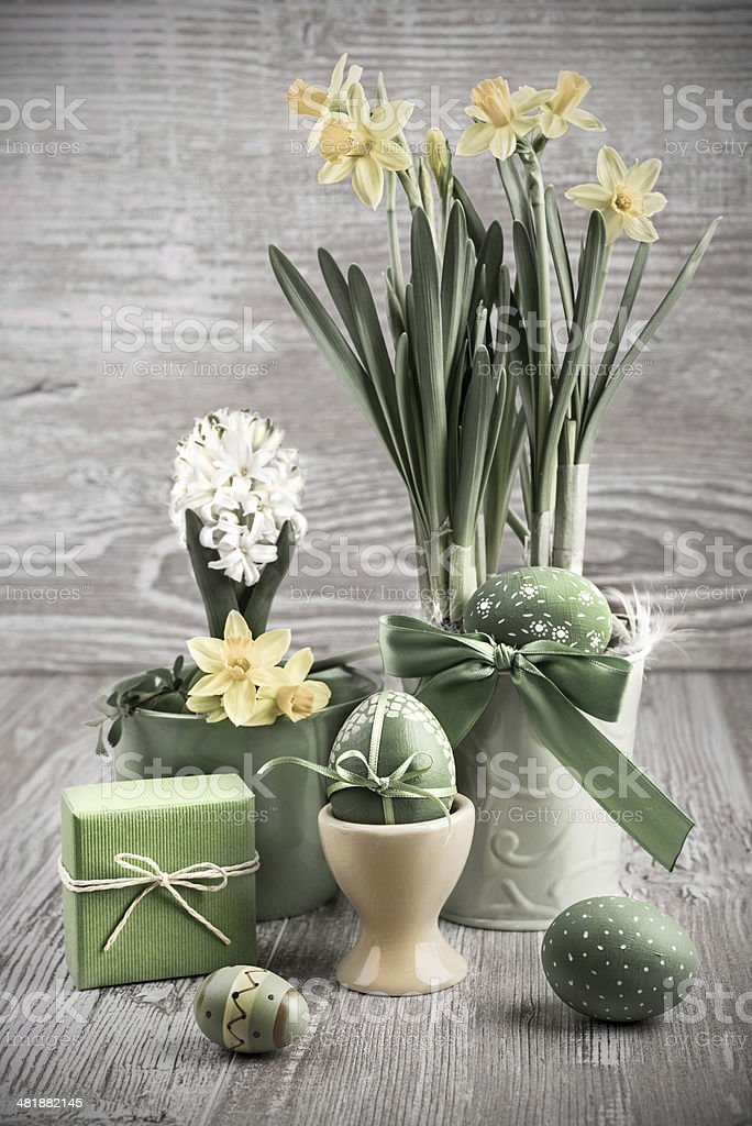 Easter composition with eggs and daffodils stock photo