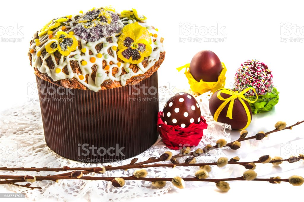 Easter composition with holiday cake, willow branches and eggs. stock photo