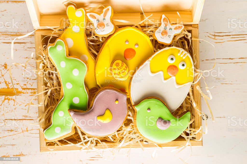 Easter cookies on white wood background stock photo