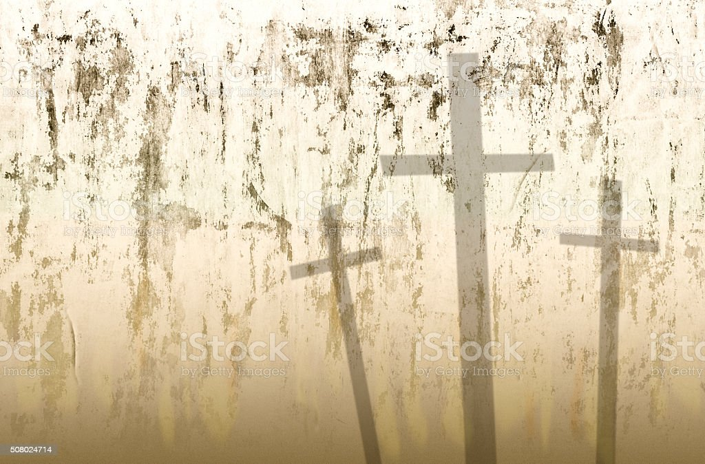 Easter. Crucifixion.  Three crosses in shadows on grunge background. stock photo