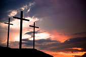 Easter. Crucifixion.  Three crosses on a hill. Good Friday.  Christianity.