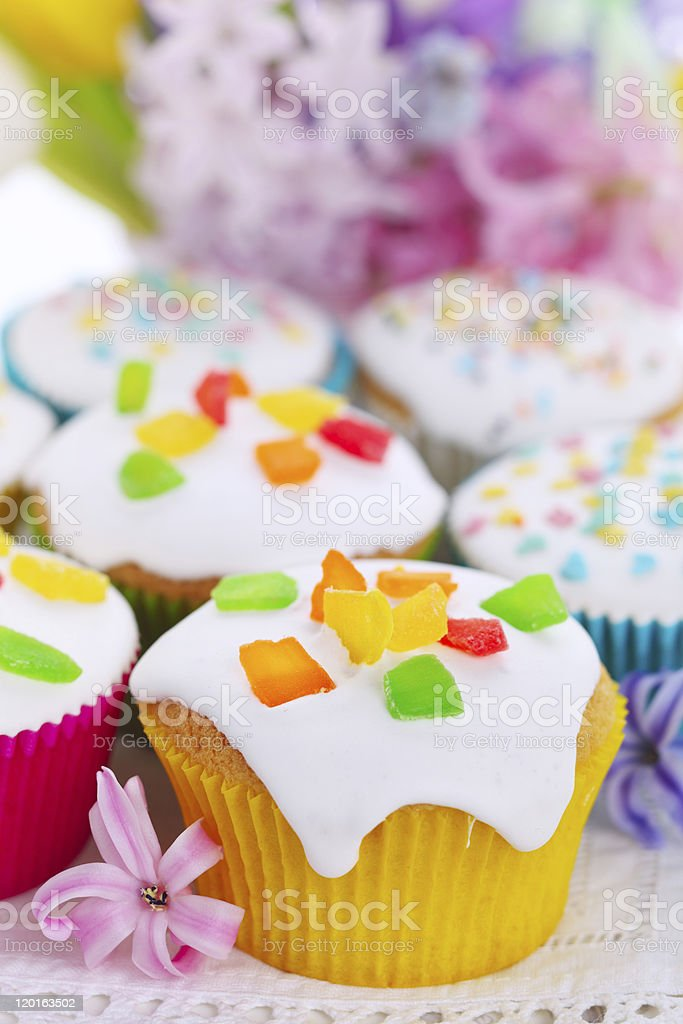 Easter cupcakes with spring flowers stock photo