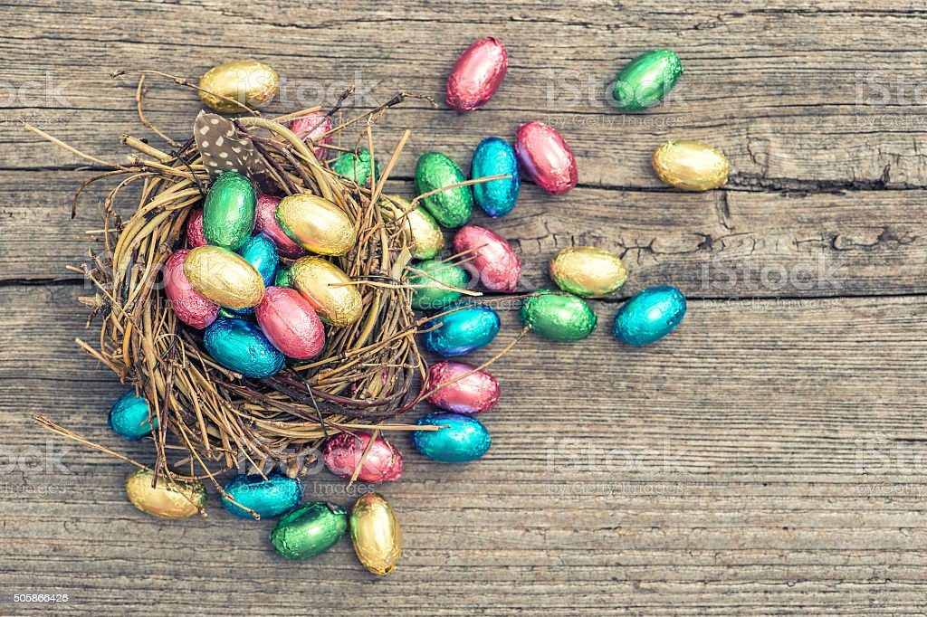Easter decoration. Chocolate eggs in nest stock photo