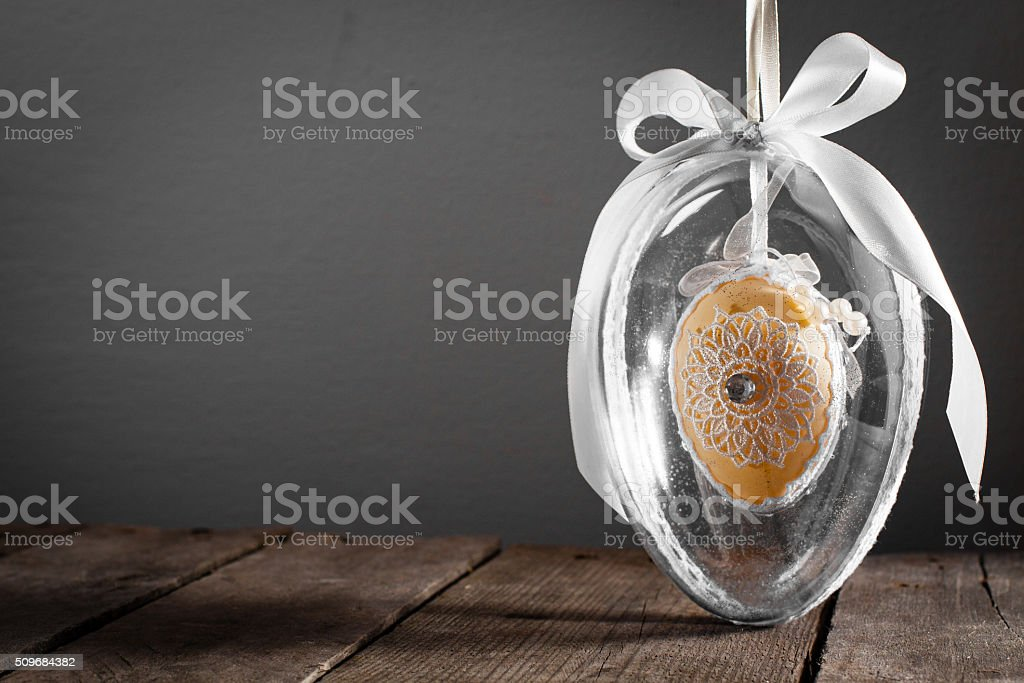 Easter decoration. Decorated egg encased in glass egg. stock photo