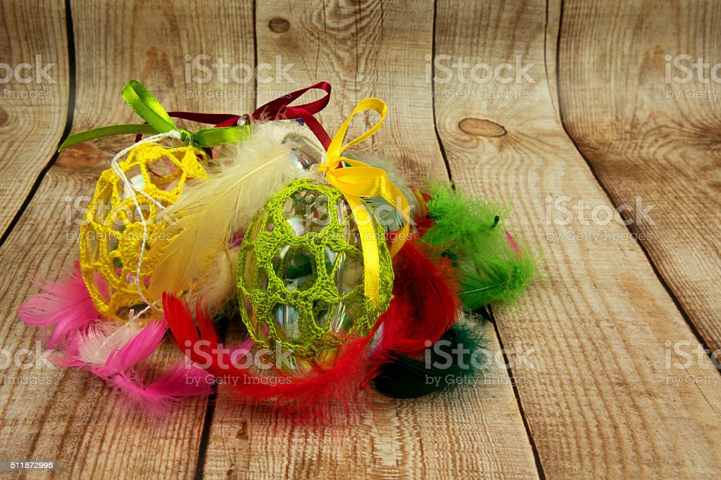 Easter decoration with colorful feathers on wooden background stock photo