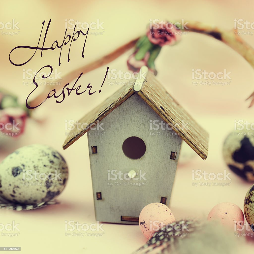 Easter decoration with eggs and feeder. Vintage style. stock photo