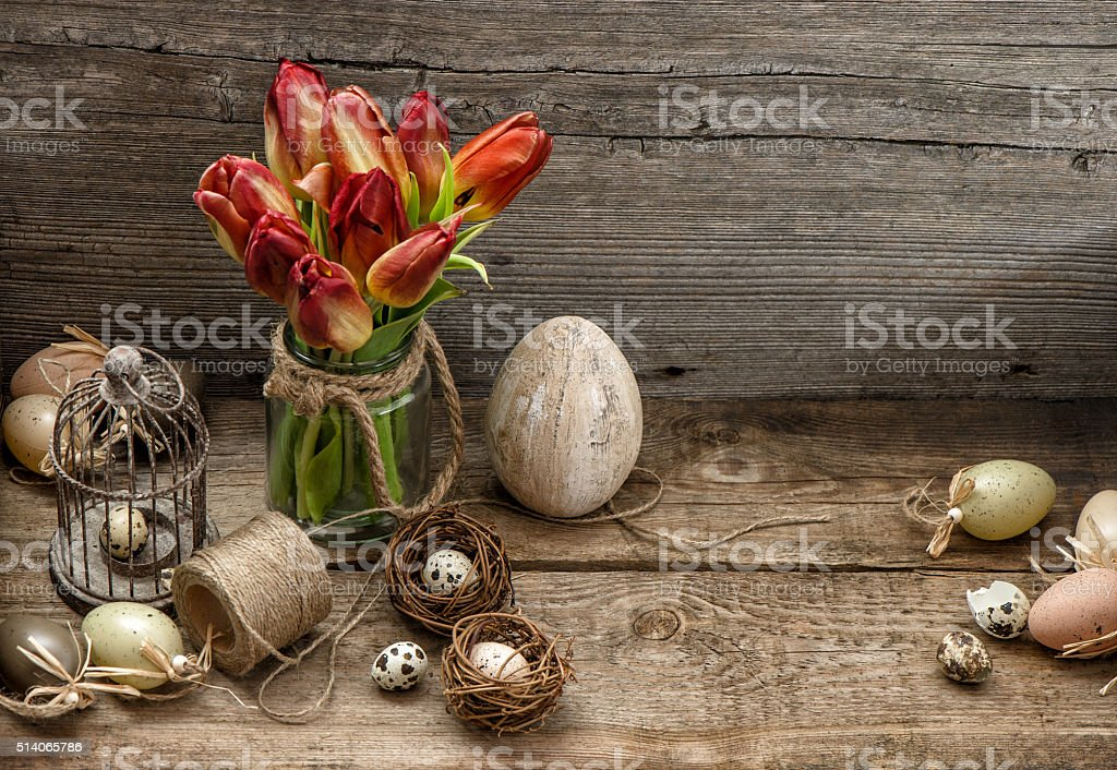 Easter decoration with eggs and tulip flowers. Country style stock photo
