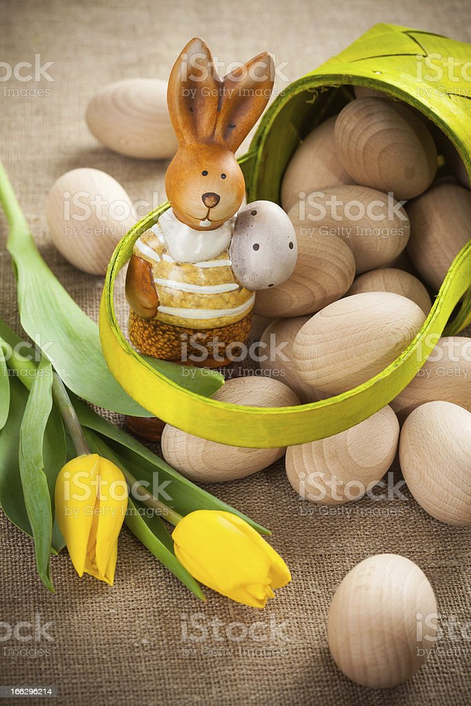 Easter decoration with rabbit, eggs and tulip royalty-free stock photo