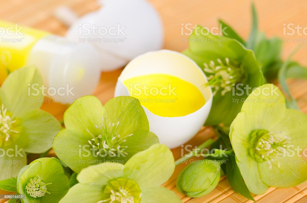 Easter decoration with yellow paint in a egg shell and stock photo