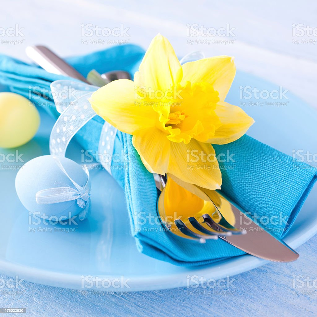 Easter decorative table setting with yellow daffodil stock photo