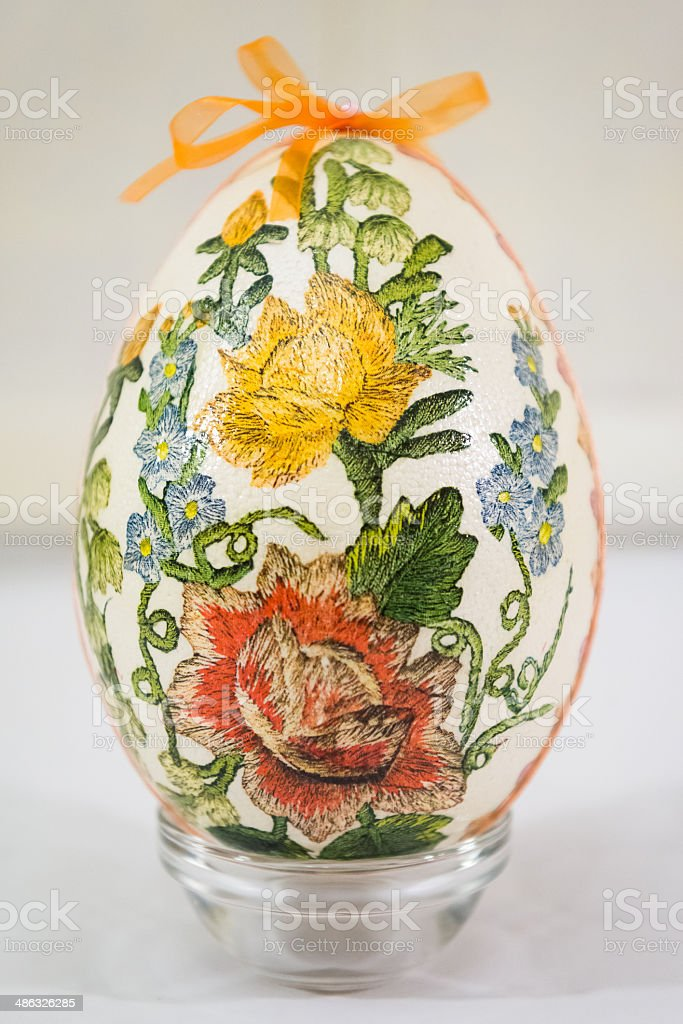 Easter egg decorated with flowers made by decoupage technique stock photo