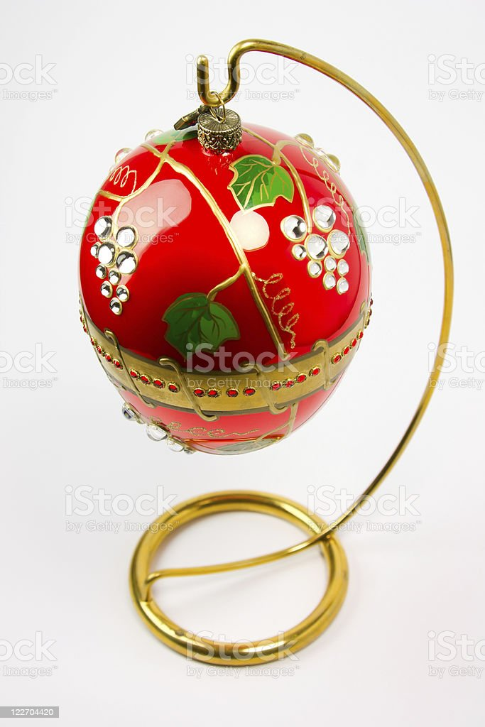 easter egg  hanging on golden stand stock photo