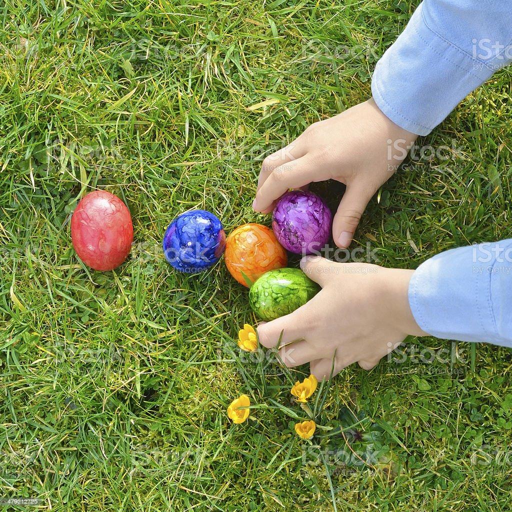Easter egg hunt in the garden stock photo