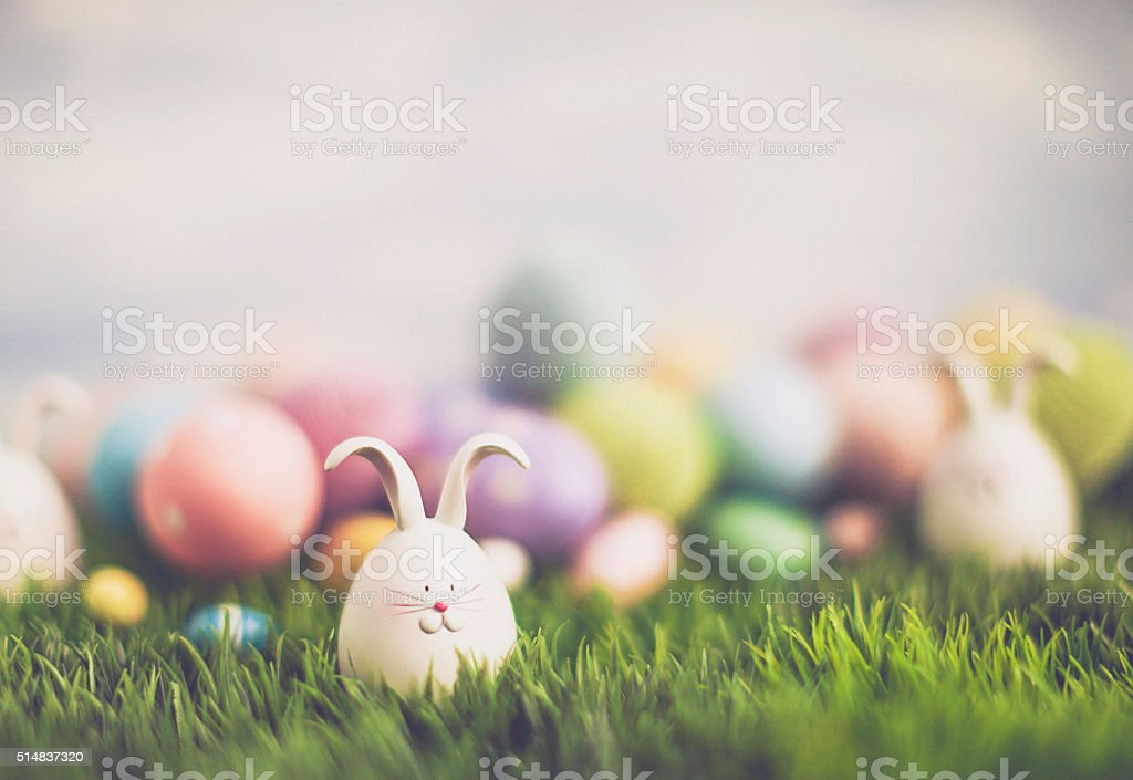 Easter egg hunt with bunnies and decorated eggs stock photo