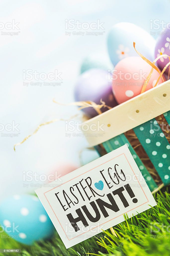 Easter egg hunt with Easter basket and decorated eggs stock photo