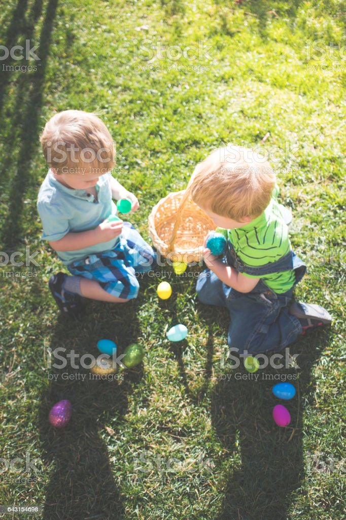 Easter Egg Hunt with Twins stock photo