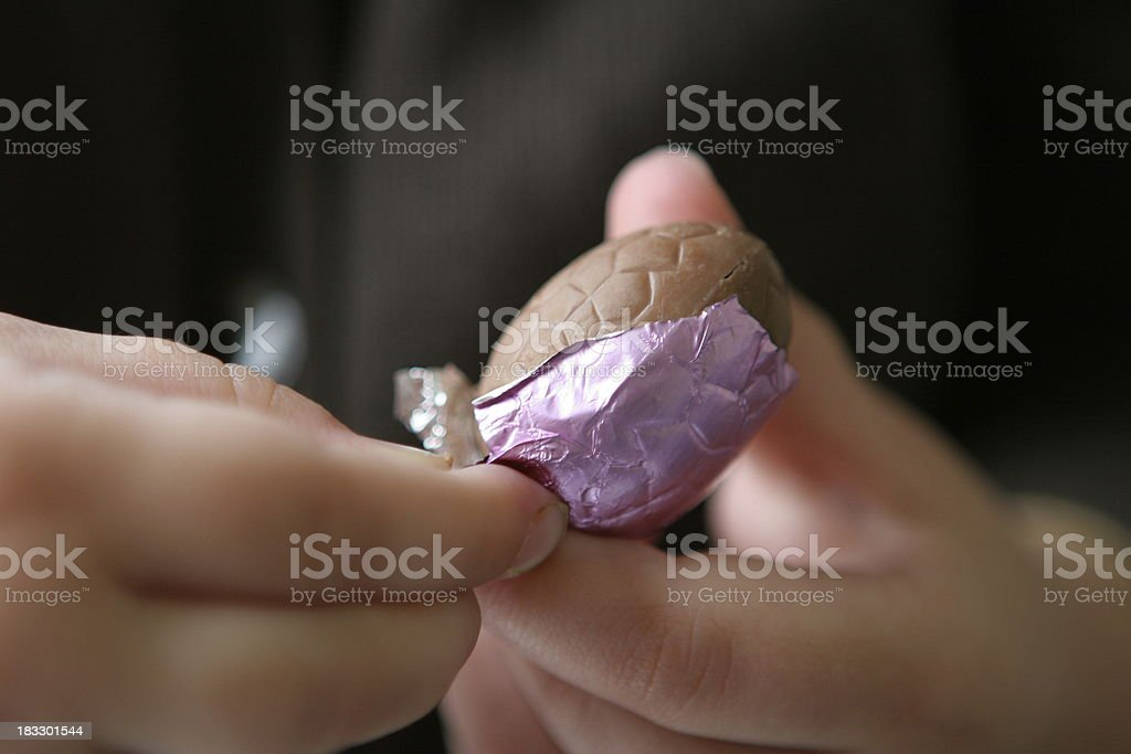Easter egg in a child's hands stock photo