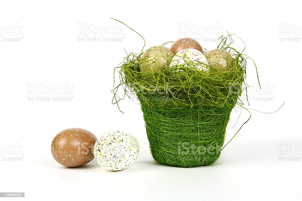 easter egg in basket isolated on white royalty-free stock photo