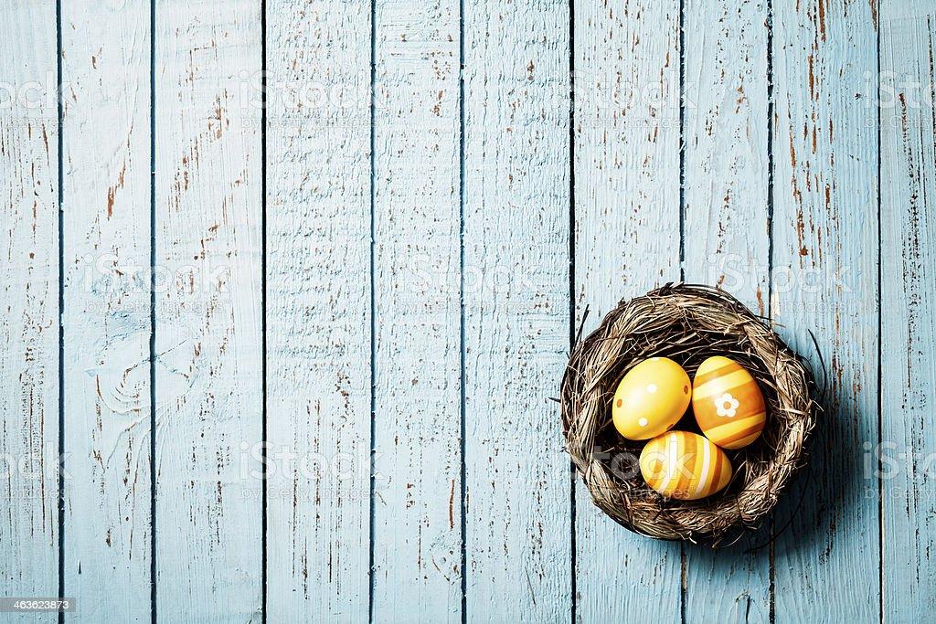 Easter Egg Nest on Blue Vintage Wood - Season Backgrounds stock photo