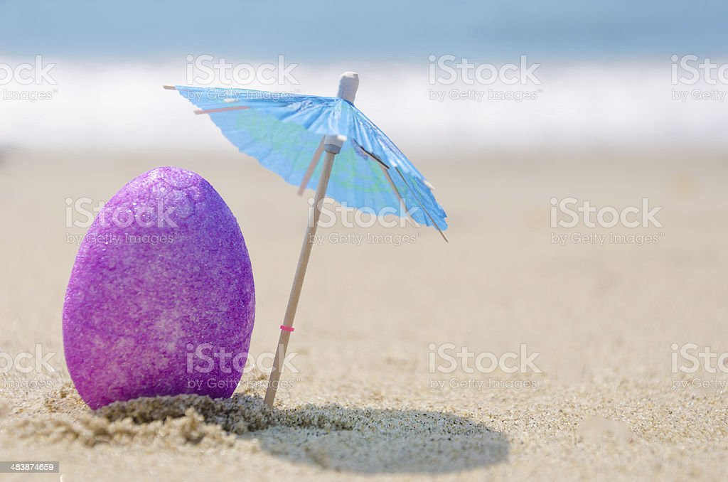 Easter egg on the beach stock photo
